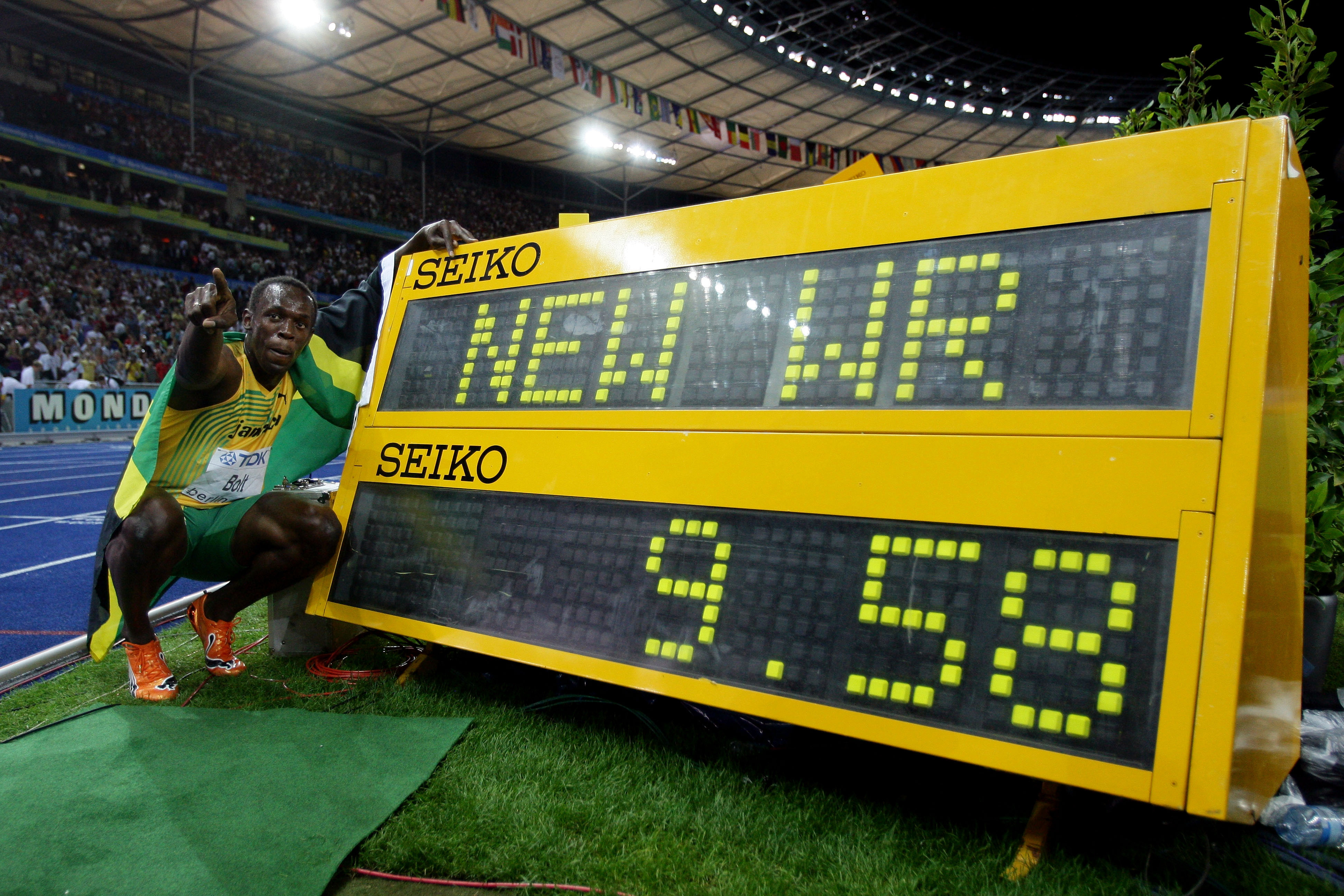 Usain Bolt celebrates winning the gold medal in the men's 100 Metres Final World Athletics Championships in Berlin. Bolt set a new World Record of 9.58.
