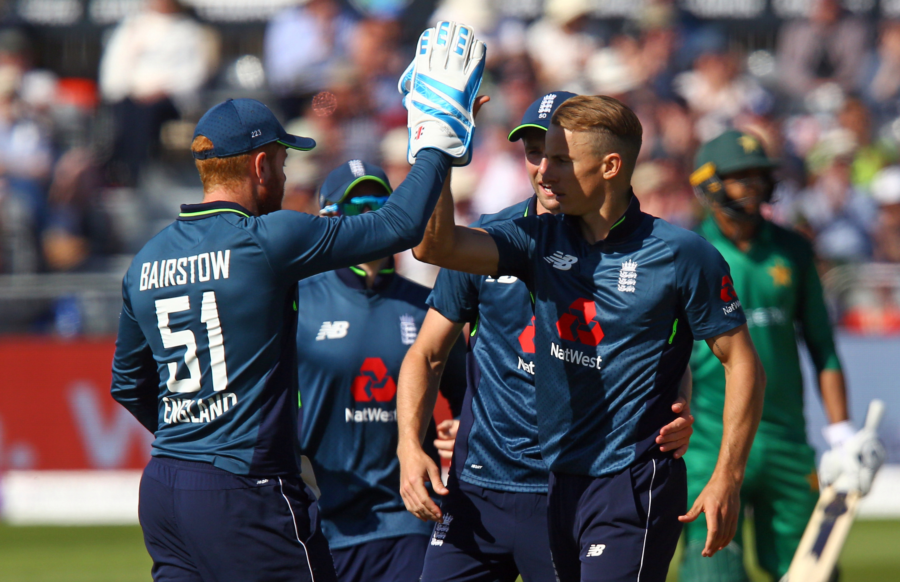 Tom Curran celebrates taking a wicket against Pakistan