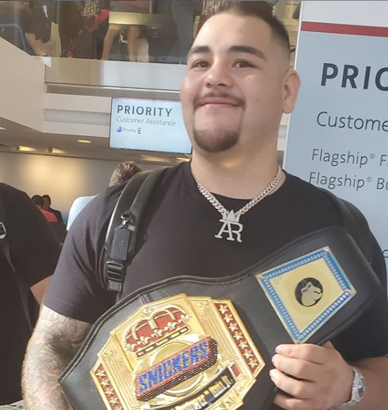 The heavyweight champion poses with his novelty belt