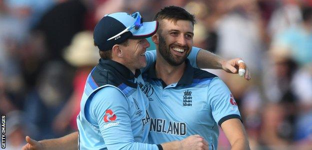 Mark Wood celebrates a wicket against New Zealand with England captain Eoin Morgan