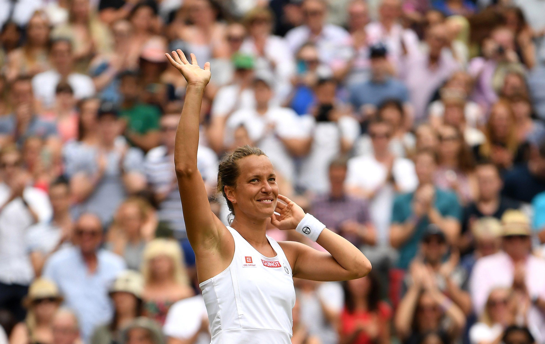 Strycova of the Czech Republic celebrates her win over Konta