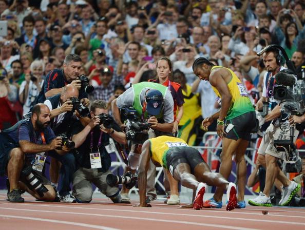 Usain Bolt does push-ups after winning 200m gold at London 2012