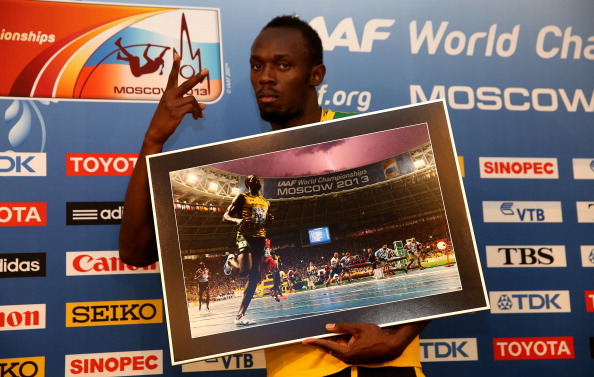 Bolt poses with the iconic image