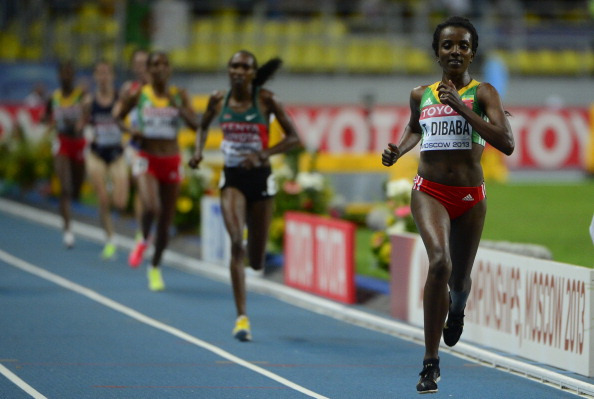 Tirunesh Dibaba swept to gold in the women's 10,000m final before Bolt's race